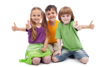 Three kids giving thumbs up sign